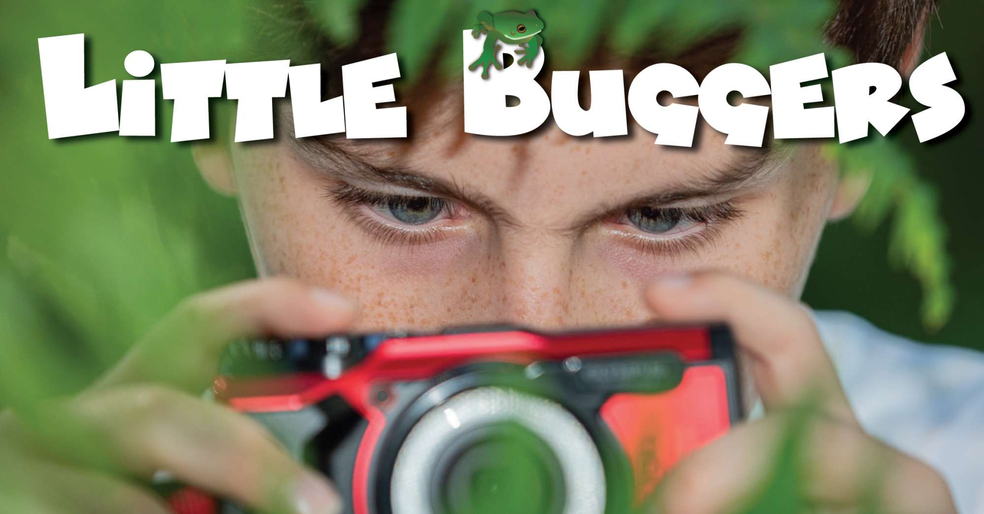 A boy with a small red camera and 'Little buggers' logo
