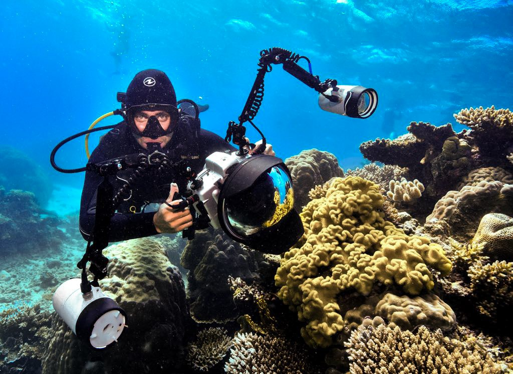 Gabriel Guzman with underwater camera